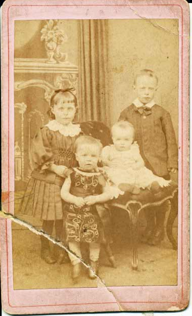 John Heslop(eldest), Martha Annie Heslop, Isaac James(in dress), baby who died.